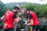 Ciclistas llena sus pomos de agua en el campamento de Soroa antes de arrancar la tercera etapa Soroa-Viñales (119 km) durante la Titán Tropic Cuba de ciclismo de montaña el martes 8 de diciembre de 2015. FOTO de Calixto N. Llanes (CUBA