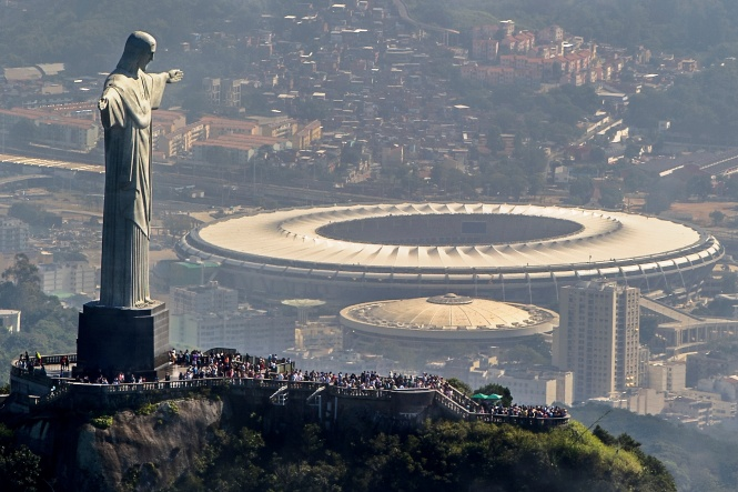 RIO DE JANEIRO, BRAZIL - MAY 10: Aerial view of the Christ the Redeemer statue atop Corcovado Hill and the Mario Filho (Maracana) stadium on May 10, 2013 in Rio de Janeiro, Brazil. (Photo by Buda Mendes/LatinContent/Getty Images). The Maracana stadium will host the upcoming Confederations Cup, the Brazil 2014 FIFA World Cup and the 2016 Summer Olympics.